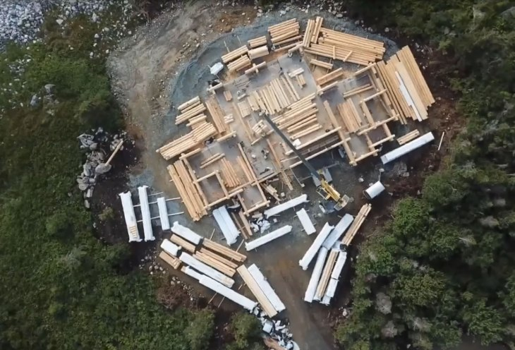 Drone view of huge log home building project