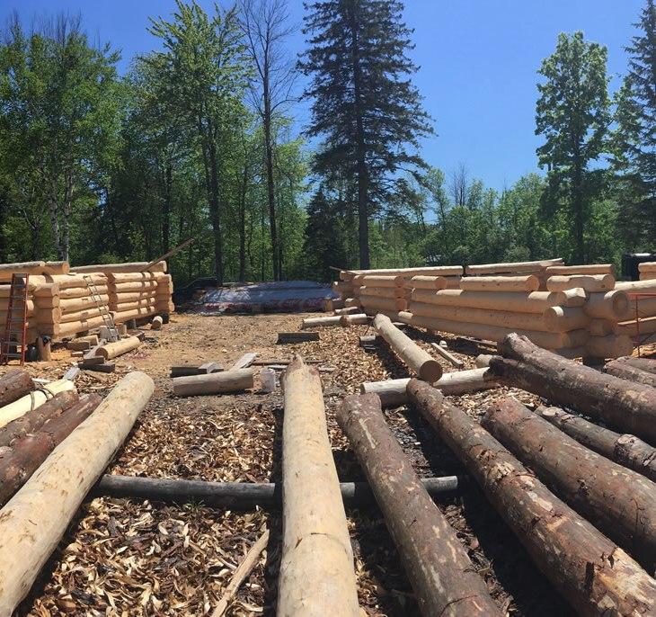 Ottawa log home shells under construction