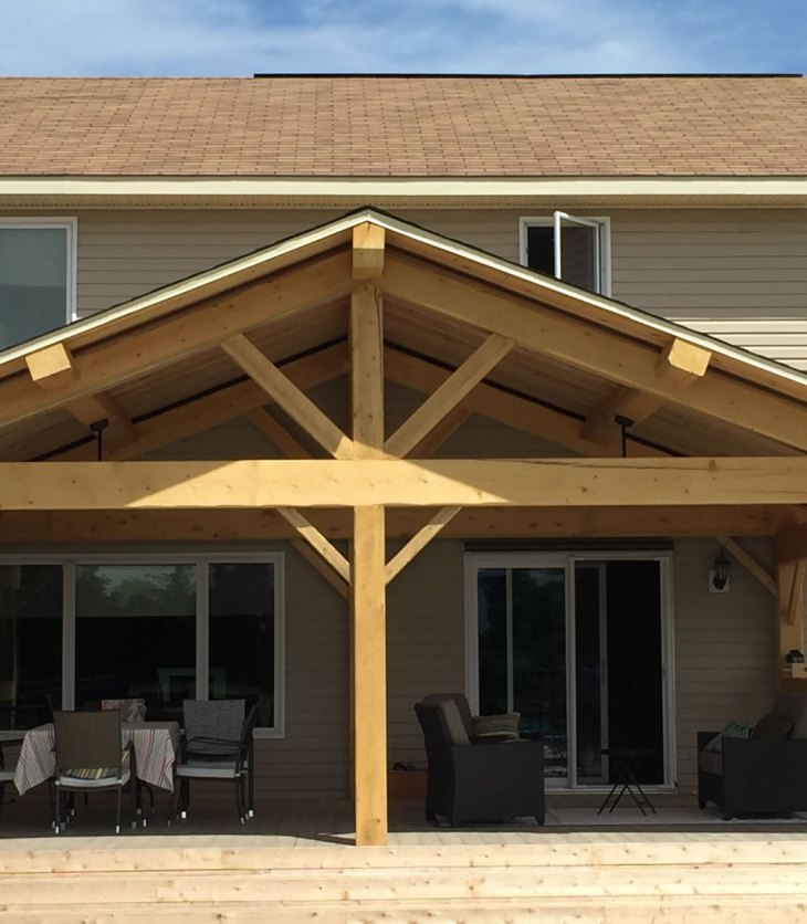 Newer home with timberframe screened in porch